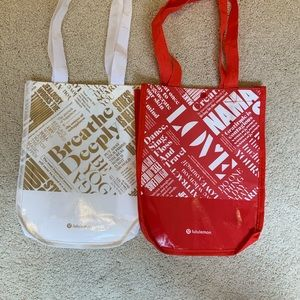 Red and white lululemon shopping bags